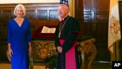 U.S. Ambassador Callista Gingrich, left, is photographed with Archbishop Jean-Louis Brugues on the occasion of the presentation to the Vatican of an authentic 15th Century copy of a letter written by Christopher Columbus.