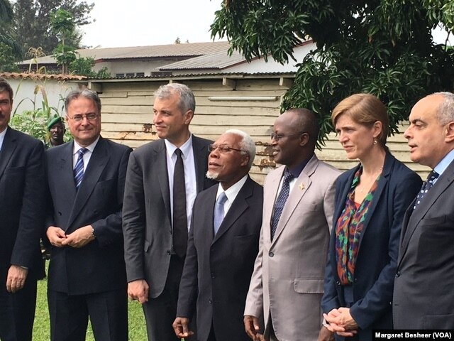FILE - Burundi's first Vice President Gaston Sindimwo, third from right, and U.S. Ambassador to the United Nations Samantha Power take a photograph at his residence in Bujumbura, Jan. 22, 2016.