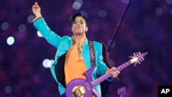 FILE - In this Feb. 4, 2007, file photo, Prince performs during the halftime show at the Super Bowl XLI football game in Miami.