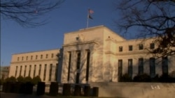 US Fed: Interest Rates Could Rise by Middle of 2015