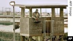 US soldier in guard tower over looking military-run Camp Delta prison in Guantanamo Bay US Naval Base, June 27, 2006