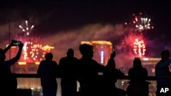 FILE - Spectators watch as fireworks explode over the Las Vegas Strip during a 4th of July Fireworks show in Las Vegas, July 4, 2021. COVID-19 cases have doubled over the past three weeks.