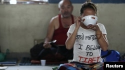 A Tibetan protester eats after the conclusion of a 24-hour hunger strike was held to express solidarity with compatriots who were victims of a Chinese crackdown in Ngaba, Sichuan Province in March, at the Tibetan Youth Club in Katmandu, Nepal, April 2011.