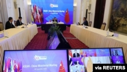 Vietnam's Deputy Prime Minister and Foreign Minister Pham Binh Minh chats in a video meeting with Chinese State Councillor Wang Yi and other leaders during the ASEAN-China ministerial meeting in Hanoi, Vietnam, Sept. 9, 2020.