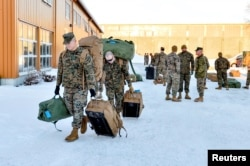 FILE - U.S. Marines, scheduled for six months of training to learn about winter warfare, arrive in Stjordal, Norway, Jan. 16, 2017.