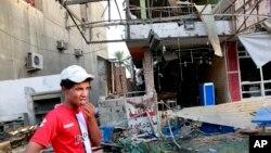Jedno od mesta bombaškog napada u predgrađu Bagdada