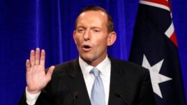 Australia's conservative leader Tony Abbott gestures as he claims victory in Australia's federal election, Sept. 7, 2013.