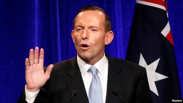 Australia's conservative leader Tony Abbott gestures as he claims victory in Australia's federal election during an election night function in Sydney, Sept. 7, 2013.