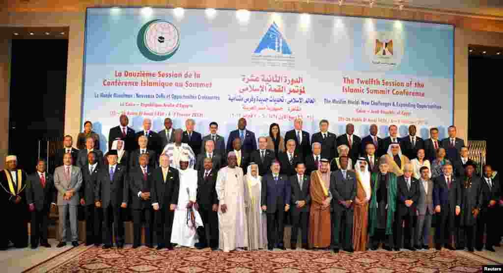 Leaders of nations taking part in the Organization of Islamic Cooperation's two-day summit, which brings together leaders from across the Muslim world, pose for a group photograph in Cairo, February 6, 2013.