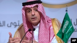 FILE - Saudi Arabia's Foreign Minister Adel al-Jubeir speaks during a press conference at the end of the Arab summit in Dhahran, Saudi Arabia, April 15, 2018.