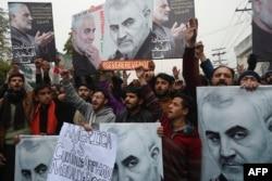 FILE - Pakistani Shiite Muslims protest the killing of top Iranian commander Qassem Soleimani in Iraq, outside the U.S. consulate in Lahore, Jan. 7, 2020.
