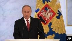 Shugaban Rasha Putin yayinda yake jawainsa na shekara shekara jiya.