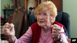 FILE - Guadalupe Portillo, who is 102, speaks during an interview in her Los Angeles home.