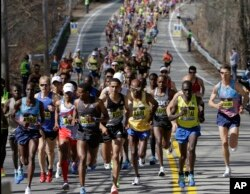 Yemane Tsegay of Ethiopia, fourth from left, leads the pack of elite men runners along the course of the 121st Boston Marathon in Hopkinton, Massachusetts, April 17, 2017.