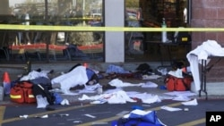 Dead bodies and debris lay on the ground after a shooting involving Rep. Gabrielle Giffords, D-Ariz, outside a shopping center in Tucson, Arizona, 08 Jan 2011