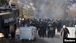Bulgarian riot police are seen inside a refugee center during clashes in the town of Harmanli, Bulgaria, Nov. 24, 2016.