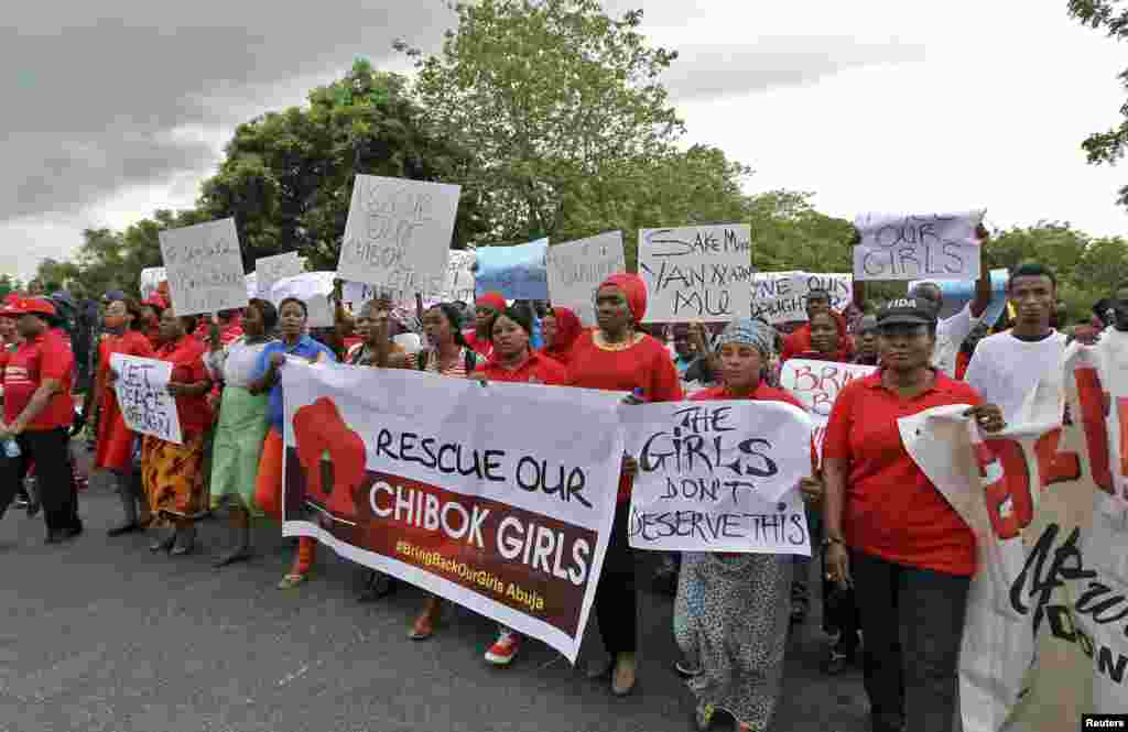 Members of various civil society organisations demonstrate in Abuja, Nigeria, April 30, 2014.