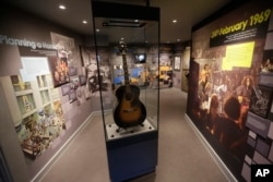 U.S. musician Jimi Hendrix's Epiphone acoustic guitar is displayed in an exhibition space at the central London flat he used to live in at 23 Brook Street, London, Feb. 8, 2016.