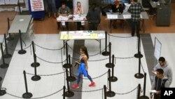 Voters walk through a polling station in Dallas, Texas, Nov. 8, 2016.