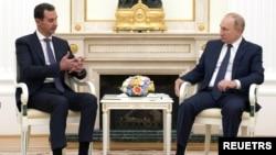 Presiden Rusia Vladimir Putin dan Presiden Suriah Bashar al-Assad di Kremlin, Moskow, Rusia, 13 September 2021. (Sputnik/Mikhail Klimentyev/Kremlin via REUTERS)