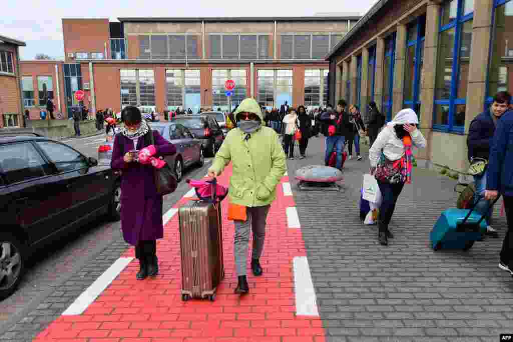 Passengers evacuating the Brussels Airport of Zaventem, after a string of explosions rocked Brussels airport and a city metro station, killing at least 21 people, as Belgium raised its terror threat to the maximum level, March 22, 2016