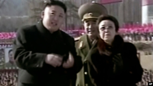 In this Feb. 16, 2013 image made from video, North Korean leader Kim Jong Un, left, along with his aunt Kim Kyong Hui, right, attends a statue unveiling ceremony in Pyongyang.