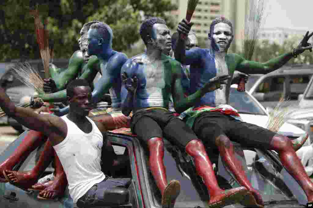Supporters of new Nigerian President, Muhammadu Buhari, celebrate after his inauguration in Abuja. Nigerians celebrated their newly reinforced democracy, dancing and singing songs and praises of Buhari, the first candidate to beat a sitting president at the polls.