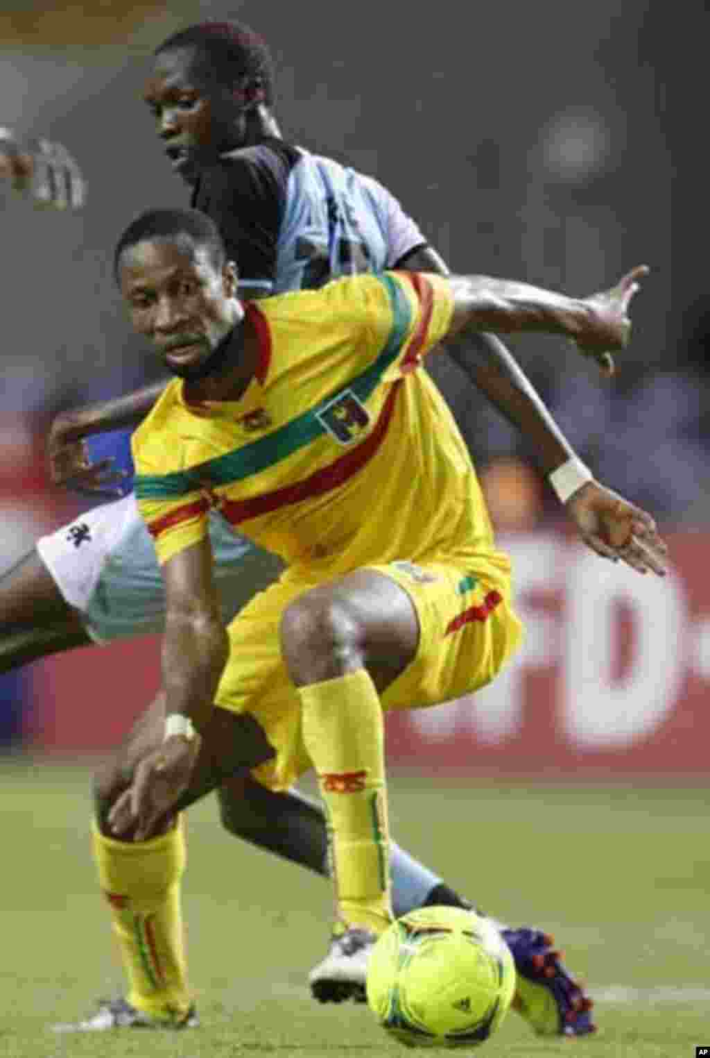 Mali's Seydou Keita (12) plays against Botswana's Mogakolodi Ngele during their final African Cup of Nations Group D soccer match at the Stade De L'Amitie Stadium in Libreville February 1, 2012.