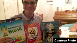 Philippe Sion displays his trading books from the last three World Cups. (Rachel Dornhelm)