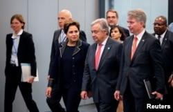 Patricia Espinosa, Executive Secretary of the United Nations Framework Convention on Climate Change, and U.N. Secretary-General Antonio Guterres arrive for the opening of the High-Level Segment of COP23 U.N. Climate Change Conference in Bonn, Germany, Nov