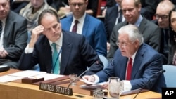 Mark Field British Minister of State for Asia and the Pacific, left, listens as U.S. Secretary of State Rex Tillerson speaks during a high-level Security Council meeting on the situation in North Korea at United Nations headquarters, Dec. 15, 2017.
