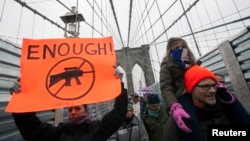 Demonstrators participate in an anti-gun violence rally sponsored by One Million Moms for Gun Control in New York, Jan. 21, 2013.