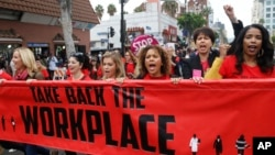 FILE - Participants march against sexual assault and harassment at the #MeToo March in the Hollywood section of Los Angeles, Nov. 12, 2017.