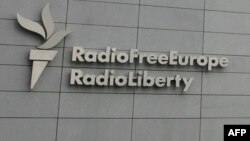 FILE - A sign for Radio Free Europe/Radio Liberty (RFE/RL) is pictured on the broadcaster's headquarters building, in Prague, Czech Republic, May 12, 2009.