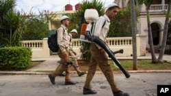 Government fumigators prepare to spray homes for mosquitoes in Havana, Cuba, Feb. 22, 2016.