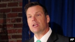 FILE - Then-Kansas Secretary of State Kris Kobach is pictured in Lenexa, Kan., June 8, 2017. Kobach has advised President Donald Trump on immigration and election fraud issues and is vice chairman of a presidential commission on voter fraud.
