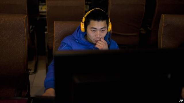 A man uses a computer at an internet cafe in central Beijing, China, Dec. 28, 2012.