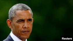 Presiden AS Barack Obama memberikan keterangan mengenai situasi di Irak dari Gedung Putih (13/6). (Reuters/Kevin Lamarque)