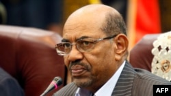 FILE - Sudan's President Omar al-Bashir speaks during a one-day summit, Sept. 3, 2013