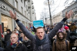 Russian opposition leader Alexei Navalny, centre, attends a rally in Moscow, Russia, Sunday, Jan. 28, 2018. Navalny was arrested Sunday in Moscow while walking with protesters, as protests take place across the country. (AP Photo/Evgeny Feldman)