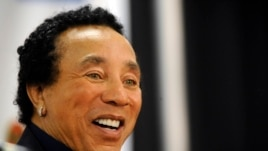 Smokey Robinson talks to the media at the Rock & Roll Hall of Fame concert in New York, Oct. 29, 2009.