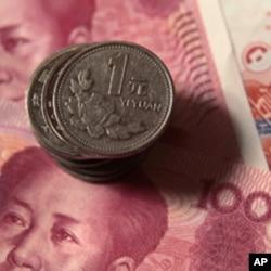 AQSh Xitoyni nafaqat demokratiyani bo'g'ishda, balki milliy valyutasi yuan qadrini sun'iy ushlab turishda ham ayblaydi.