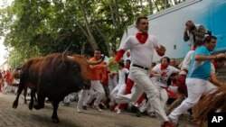 Festival San Fermin, atau festival pelepasan banteng liar di Pamplona, Spanyol utara (12/7).