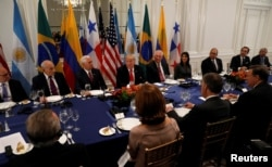 U.S. President Donald Trump, center, attends a working dinner with Latin American leaders in New York, Sept. 18, 2017.