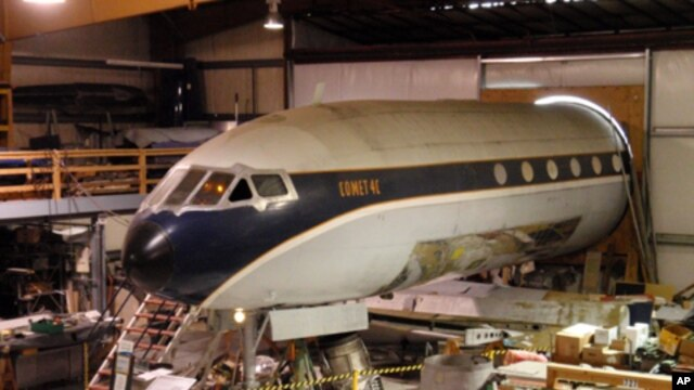 Only the front half of the de Havilland Comet - the first jet airliner in passenger service - fits into the restoration hanger.