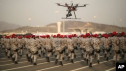 FILE - A military parade by Saudi security forces in preparation for the annual Hajj pilgrimage in Mecca, Saudi Arabia.