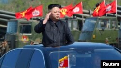 FILE - North Korea's leader Kim Jong Un inspects artillery launchers ahead of a military drill marking the 85th anniversary of the establishment of the Korean People's Army, April 25, 2017.