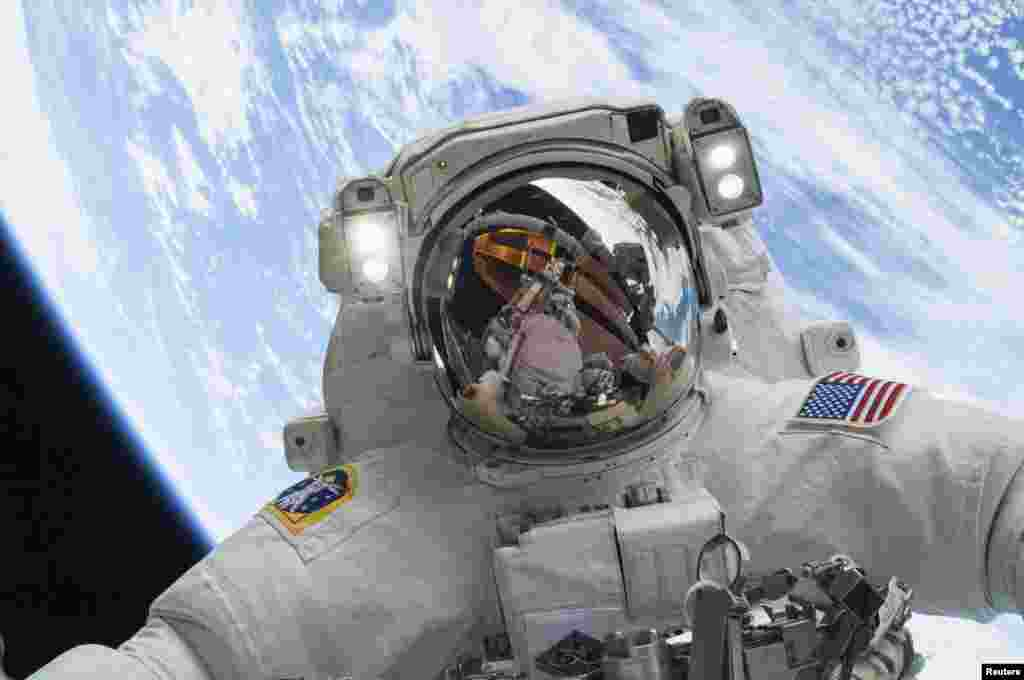 Astronaut Mike Hopkins, Expedition 38 Flight Engineer, is shown in this NASA handout photo released Friday, as he participates in the second of two spacewalks which took place on Dec. 24, 2013.