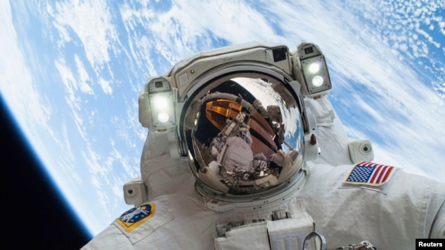 Astronaut Mike Hopkins, Expedition 38 Flight Engineer, is shown in this handout photo provided by NASA as he participates in the second of two spacewalks which took place on December 24, 2013, released on December 27, 2013.