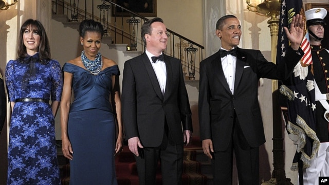 President Barack Obama and first lady Michelle Obama pose for an official photo with British Prime Minister David Cameron and his wife, Samantha Cameron, before the White House state dinner, March 14, 2012.